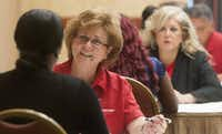 Carolyn Poling interviews a candidate during a State Farm Insurance job fair in Richardson. The company is hiring 700 people for a call center being built in Richardson.
