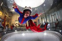 IAN HOOK-ADAMS , 11, learns how to indoor skydive with the help of instructor Dave Rhea at iFly in Frisco. After some introductory lessons, Ian took to the flight chamber.Photos by TOM FOX/DMN - Staff Photographer
