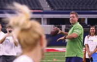 Troy Aikman threw the ball to Amy Holderman, principal of Bennett Elementary School in McKinney ISD, at a celebration of the Healthy Zone School Recognition Program at AT&T Stadium in September.( Ron Baselice  -  Staff Photographer )