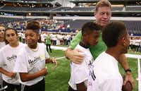Troy Aikman pals around with students from Arlington ISD's Young Junior High School at the Healthy Zone School Recognition Program celebration. From left, the students are Rylee Richardson, Cassady Frey, Ta'Naya Thurmund, K.J. Polk and Christian Traylor.( Ron Baselice  -  Staff Photographer )