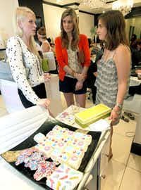 Alysa Teichman (right), who works for a New York shoe company, hosted a pedicure  party at Posh Nail Spa for a dozen fashion bloggers. The party favors: $105 sandals.