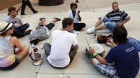 Occupy Dallas protesters waited outside the Lew Sterrett Justice Center for the release of 23 protesters who were arrested Monday afternoon after blocking the entrance to the Chase bank branch at Main Street and Akard Street.