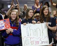 Colleyville Middle School students Shaye Hatley, Shannon Peek and Christine Wendt show their support.