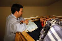 After a long day of school, tutoring and video games, Zach Thibodeaux and his father, Adam Thibodeaux, say the Our Father prayer before Zach goes to sleep in his bunk bed.