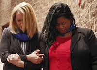 Cedar Hill councilwoman Jami McCain (left) and Aranda Bell joined in prayer Sunday at the Martin Luther King Jr. Celebration at Cedar Hill High School.( Ron Baselice  -  Staff Photographer )