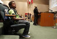 David Williams, 12, waits for his turn to speak at a Dallas City Council meeting. He routinely  addresses the council with his mother.