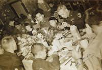 This photograph of Juan Sanchez (center) won a trip to South Korea for him later this fall. Soldiers dined with orphans in Korea on Christmas 1952.