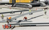 Construction workers assembled girders at the construction site for The Star in Frisco on Saturday.( Michael Ainsworth  -  Staff Photographer )