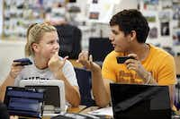 Emma McCrady, 15, of Lewisville, confers with classmate Daniel Rosas, 15, of Carrollton, during class.