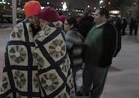 Dylan Prater and Taylor Eastman tried to stay warm outside the J.C. Penney store at Timber Creek Crossing in Dallas. Penney didn't open until 4 a.m. Friday; many rivals welcomed shoppers four hours earlier.