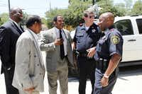 Justice Seekers Texas members Rev. Ronald Wright (from right), Mickey Wright and the Rev. Rodney Whetstone spoke Wednesday with Dallas County Sheriff Capt. Mark Howard (second from right) and Lt. Raymond Williams (far right) about the shooting.