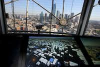Large viewing screens in the observation deck area show a variety of informative videos, as seen during a tour of the revamped Reunion Tower in Dallas, which is scheduled to reopen Saturday.