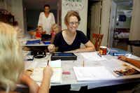 """Christa Downer teaches Hayden O'Donnell-Downer, 8, left, and Danijela Perge, 8, at home. """"I love it,"""" Downer said. """"I'm just so happy to be this engaged in their education."""""""