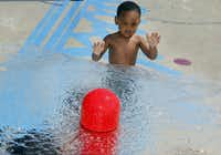 Jordan Hillary, 2, was a little wary of the water as he tried to cool off Thursday at the Splash Pad at C.O. Bruce Central Park in Seagoville.
