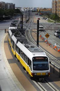 The new DART Orange Line train crosses O'Connor Blvd as it approaches the Las Colinas Urban Center Station before its kickoff party.