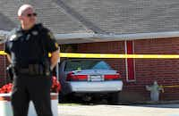 A police officer guarded the scene after the Rev. Danny Kirk was beaten to death at his church.