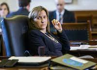 Sen. Konni Burton, R-Colleyville, listens to discussions on open carry legislation.(Ashley Landis - Staff Photographer)