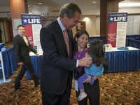 Lt. Governor David Dewhurst talks with Melissa Pici, the outreach development director with Texans Right to Life, and her daughter, Isabella, 2, after he gave a speech at the National Right to Life Convention on Saturday.