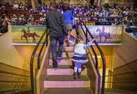 Audience members make their way to their seats between hand-painted murals that hang over each entrance to the historic 1936 Will Rogers Coliseum, home of the Fort Worth Stock Show & Rodeo.( Ashley Landis  -  Staff Photographer )