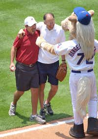 On Father's Day 2005, Steve Blow caught a pregame first pitch from son Corey at a Rangers game. Corey survived sudden cardiac death the previous year.( File Photo  -  The Associated Press )
