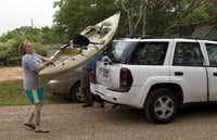 Becky Queen of Weatherford helps her husband Ray unload their kayak at Moss Lake near Gainsville. Ray Queen, an Iraq veteran, gets great enjoyment in the kayaking outings for wounded veterans sponsored by the Heroes on the Water.