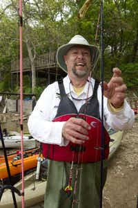 Jim Dolan picks a rod before fishing on Moss Lake near Gainsville.
