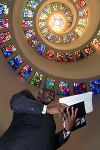 Yahya Abdullah, from a DeSoto mosque, reads a Muslim prayer during the National Day of Prayer celebrations on Thursday, May 3, 2012 in the Chapel at Thanks-giving Square in downtown Dallas.