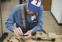 Volunteer Harold Hulme, 85, assembles toy jeeps at The Hobby Crafters Foundation's new building in Garland. He has been volunteering with the group for 20 years.(Photos by REX C. CURRY - special contributor)