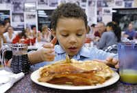 Brian Armes, 5, got ready to dig into a stack of pancakes at Big State Fountain Grill on Monday.(David Woo - Staff Photographer)