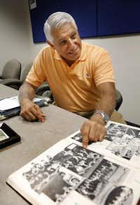 Al Martínez, pointing out his photo in a 1955 yearbook from a school in Cuba, was 13 when he arrived in the U.S. in Operation Pedro Pan in 1962. Communism-fearing Cuban parents sent about 14,000 children away.(Evans Caglage - Staff Photographer)