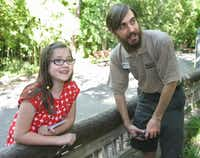 KATIE DAMM , 9, interviews primate keeper Mikey Marazzi in front of the titi monkey enclosure at the Dallas Zoo.(Photos by KELLEY CHINN - Special Contributor)
