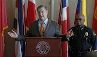 Mayor Mike Rawlings (left) spoke about the crime reduction strategy with Dallas Police Chief David Brown during a news conference Thursday at Dallas City Hall. (Jae S. Lee/Staff Photographer)