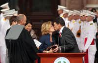 Texas First Lady Anita Perry gets a kiss from Texas Gov. Rick Perry after he is sworn in by Wallace B. Jefferson, Chief Justise of the Supreme Court of Texas.