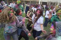 Revelers covered in colored powder danced to Indian music during this year's Holi celebration at the D/FW Hindu Temple in Irving on Sunday.( Kelley Chinn  -  Special Contributor )