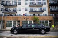 People cheered from apartment balconies as President Barack Obama passed in a presidential limousine on South Lamar Street in Dallas Saturday. (Ashley Landis/Staff Photographer)