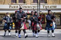 The Plano Fire Department and Bagpipe Corps led firetrucks down First Street during Monday's event.( Ashley Landis  -  Staff Photographer )