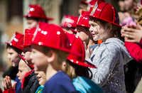 Members of the North Lamar Second Grade Choir, wearing firefighter hats, lent their voices to the occasion.( Ashley Landis  -  Staff Photographer )