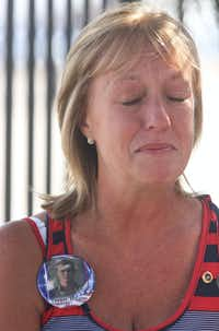 Shelley Simpson of Fort Worth gets emotional at Meacham International Airport where the body of Army Spc. William R. Moody just arrived on Wednesday, July 3, 2013. Simpson says she was here more than a year ago when the body of her nephew, who was an Army ranger killed in Afghanistan, returned home to Sulphur Springs. Simpson is wearing a button of a picture of her nephew Tanner Higgins. Simpson came to pay her respects to Moody, who was also killed in an Afghanistan.(KELLEY CHINN - Special Contributor)