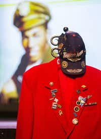 The Tuskegee Airman jacket and hat of retired Army Air Corps 1st Lieutenant Calvin Spann is displayed during funeral services for Spann on Saturday, September 12, 2015 at Covenant Church in Carrollton, Texas.  Spann was an original Tuskegee Airman and fighter pilot with the 100th Fighter Squadron of the 332nd Fighter Group.  He served during World War II, when he flew 26 combat missions. (Ashley Landis/The Dallas Morning News)(Ashley Landis - Staff Photographer)