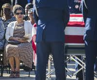 Gwenelle Johnson Spann watches as a military honor guard stands guard around the remains of her husband during funeral services for retired Army Air Corps 1st Lieutenant Calvin Spann on Saturday, September 12, 2015 at Covenant Church in Carrollton, Texas.  Spann was an original Tuskegee Airman and fighter pilot with the 100th Fighter Squadron of the 332nd Fighter Group.  He served during World War II, when he flew 26 combat missions. (Ashley Landis/The Dallas Morning News)(Ashley Landis - Staff Photographer)
