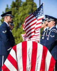 A military honor guard stands guard over the remains of retired Army Air Corps 1st Lieutenant Calvin Spann during funeral services  on Saturday, September 12, 2015 at Covenant Church in Carrollton, Texas.  Spann was an original Tuskegee Airman and fighter pilot with the 100th Fighter Squadron of the 332nd Fighter Group.  He served during World War II, when he flew 26 combat missions. (Ashley Landis/The Dallas Morning News)(Ashley Landis - Staff Photographer)