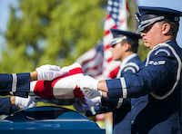 A military honor guard folds an American flag over the remains of retired Army Air Corps 1st Lieutenant Calvin Spann during funeral services  on Saturday, September 12, 2015 at Covenant Church in Carrollton, Texas.  Spann was an original Tuskegee Airman and fighter pilot with the 100th Fighter Squadron of the 332nd Fighter Group.  He served during World War II, when he flew 26 combat missions. (Ashley Landis/The Dallas Morning News)(Ashley Landis - Staff Photographer)