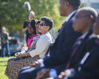 Gwenelle Johnson Spann, center, and her children and grandchildren watch as a military honor guard stands guard around the remains of her husband during funeral services for retired Army Air Corps 1st Lieutenant Calvin Spann on Saturday, September 12, 2015 at Covenant Church in Carrollton, Texas.  Spann was an original Tuskegee Airman and fighter pilot with the 100th Fighter Squadron of the 332nd Fighter Group.  He served during World War II, when he flew 26 combat missions. (Ashley Landis/The Dallas Morning News)(Ashley Landis - Staff Photographer)