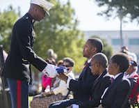 U.S. Marine Major Alejandro House, retired, presents an American flag to Calvin J. Spann II during funeral services for Spann's father, retired Army Air Corps 1st Lieutenant Calvin Spann, on Saturday, September 12, 2015 at Covenant Church in Carrollton, Texas.  Spann was an original Tuskegee Airman and fighter pilot with the 100th Fighter Squadron of the 332nd Fighter Group.  He served during World War II, when he flew 26 combat missions. (Ashley Landis/The Dallas Morning News)(Ashley Landis - Staff Photographer)