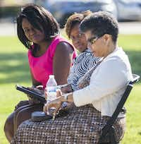 Dr. Carla Spann Lopez, left, and Gai Spann look at their mother, Gwenelle Johnson Spann, right, during funeral services for her husband, retired Army Air Corps 1st Lieutenant Calvin Spann on Saturday, September 12, 2015 at Covenant Church in Carrollton, Texas.  Spann was an original Tuskegee Airman and fighter pilot with the 100th Fighter Squadron of the 332nd Fighter Group.  He served during World War II, when he flew 26 combat missions.   (Ashley Landis/The Dallas Morning News)(Ashley Landis - Staff Photographer)