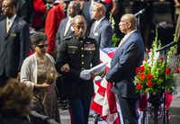 U.S. Marine Major Alejandro House, retired, escorts Gwenelle Johnson Spann during funeral services for her husband, retired Army Air Corps 1st Lieutenant Calvin Spann, on Saturday, September 12, 2015 at Covenant Church in Carrollton, Texas.  Spann was an original Tuskegee Airman and fighter pilot with the 100th Fighter Squadron of the 332nd Fighter Group.  He served during World War II, when he flew 26 combat missions. (Ashley Landis/The Dallas Morning News)(Ashley Landis - Staff Photographer)