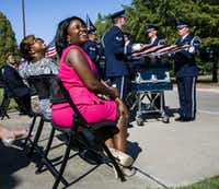 Gai Spann, left, and Dr. Carla Spann Lopez, center, smile as military planes fly overhead during funeral services for their father, retired Army Air Corps 1st Lieutenant Calvin Spann, on Saturday, September 12, 2015 at Covenant Church in Carrollton, Texas.  Spann was an original Tuskegee Airman and fighter pilot with the 100th Fighter Squadron of the 332nd Fighter Group.  He served during World War II, when he flew 26 combat missions. (Ashley Landis/The Dallas Morning News)(Ashley Landis - Staff Photographer)
