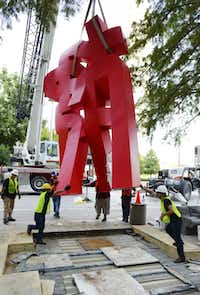 A Buddha sculpture is being installed as part of the Crow Collection's Sculpture Garden, which will open in October.