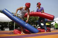 Travis Anderson and David Montez battle during the First Annual Teen Pride event in Dallas, Saturday, Sept. 14, 2013.