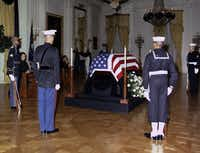 "November 23, 1963 - President Kennedy's body lies in state in the East Room of the White House. At front left, back to camera, is U.S. Marine's Lieutenant William F. Lee. In the days after the president's death, Lee found himself guarding JFK's casket - the ""Death Watch"" - at the White House and the Capitol Rotunda."
